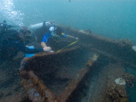 Dr. Nathan Richards measuring frames of shipwreck, Ivanhoe, located off Kauai, HI.