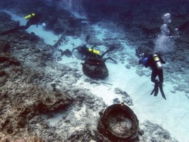 Archaeologists investigating the wreck of the British whaler Pearl, lost at Pearl and Hermes Atoll in 1822.